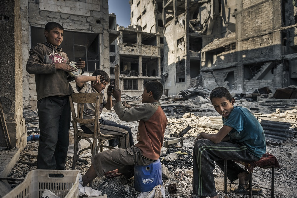 Homeless children play in the ruins of Homs after Opposition forces left the area. During the siege, children were left to fend for themselves when their parents went missing or were caught on the wrong side of newly established checkpoints.