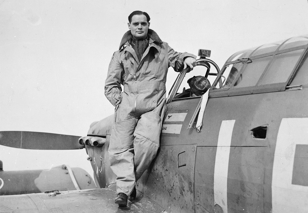 Douglas Bader posing for the camera on his Hawker Hurricane