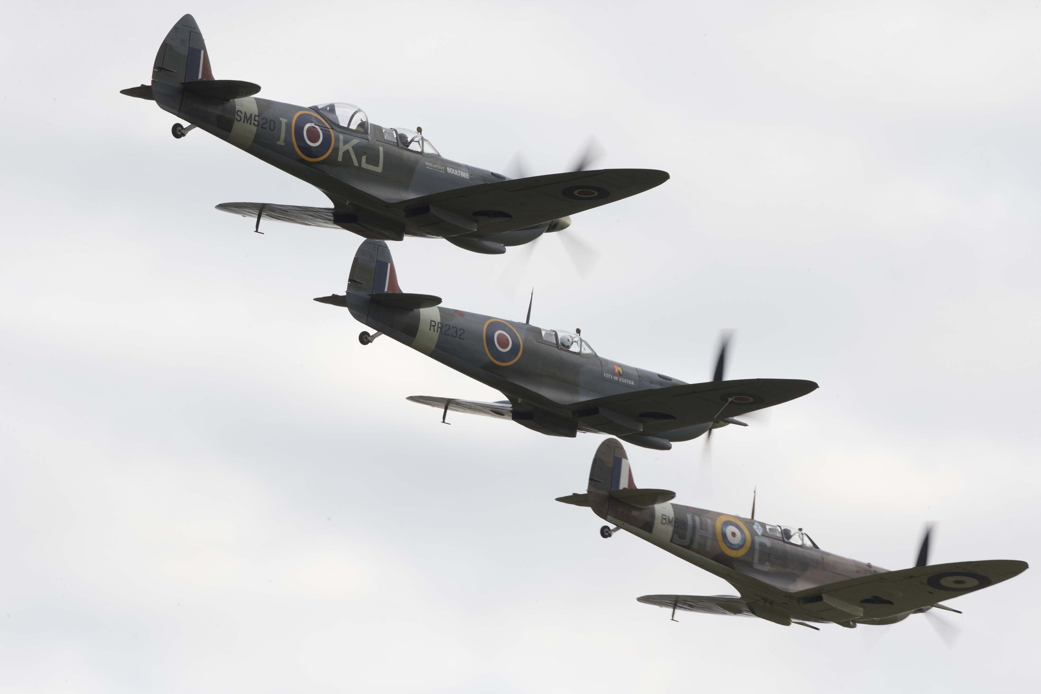 Three Spitfires flying at Battle of Britain Airshow