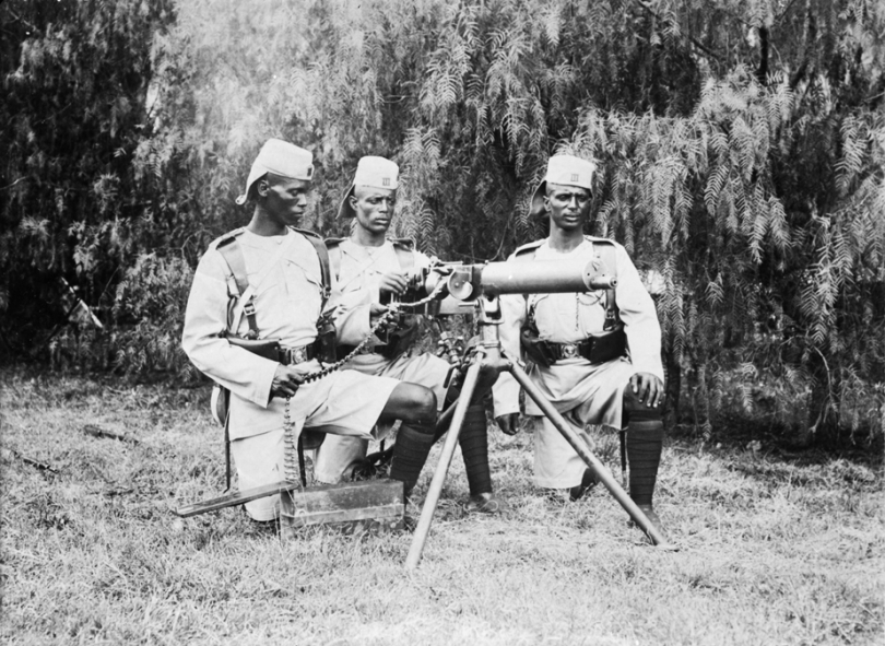 Three members of the King's African Rifles posing with a Maxim Gun