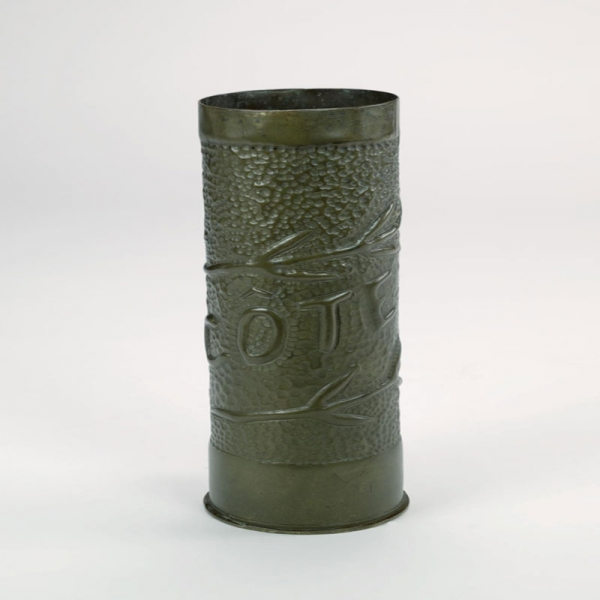This decorated shell case is an example of French First World War trench art from the Western Front.