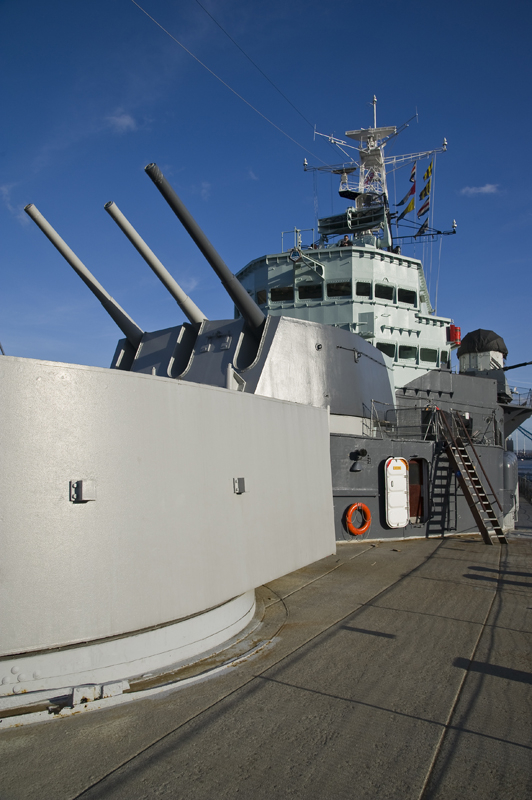 Photo of HMS Belfast's forward guns with the bridge in the background