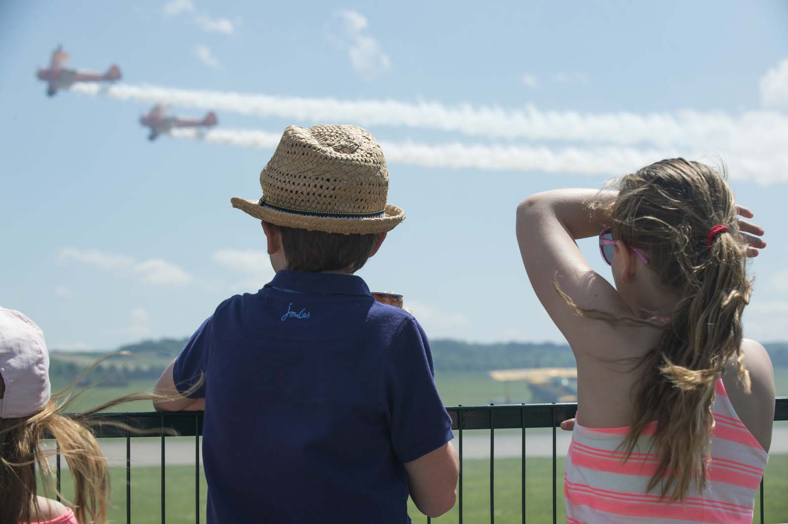 Children looking on as Wingwalkers fly past