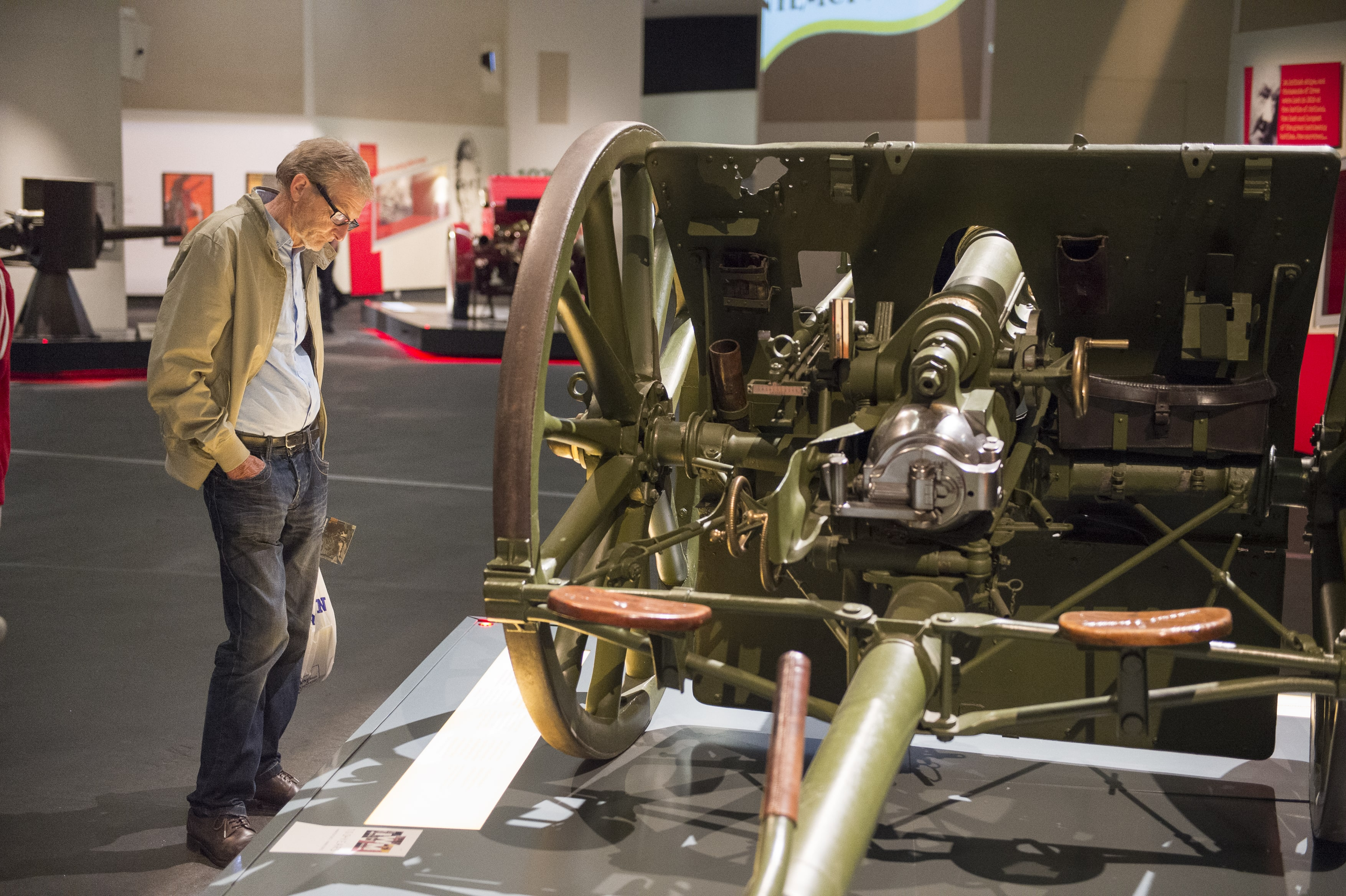 An IWM North visitor viewing the First World War Field Gun on display in the Main Exhibition Space.