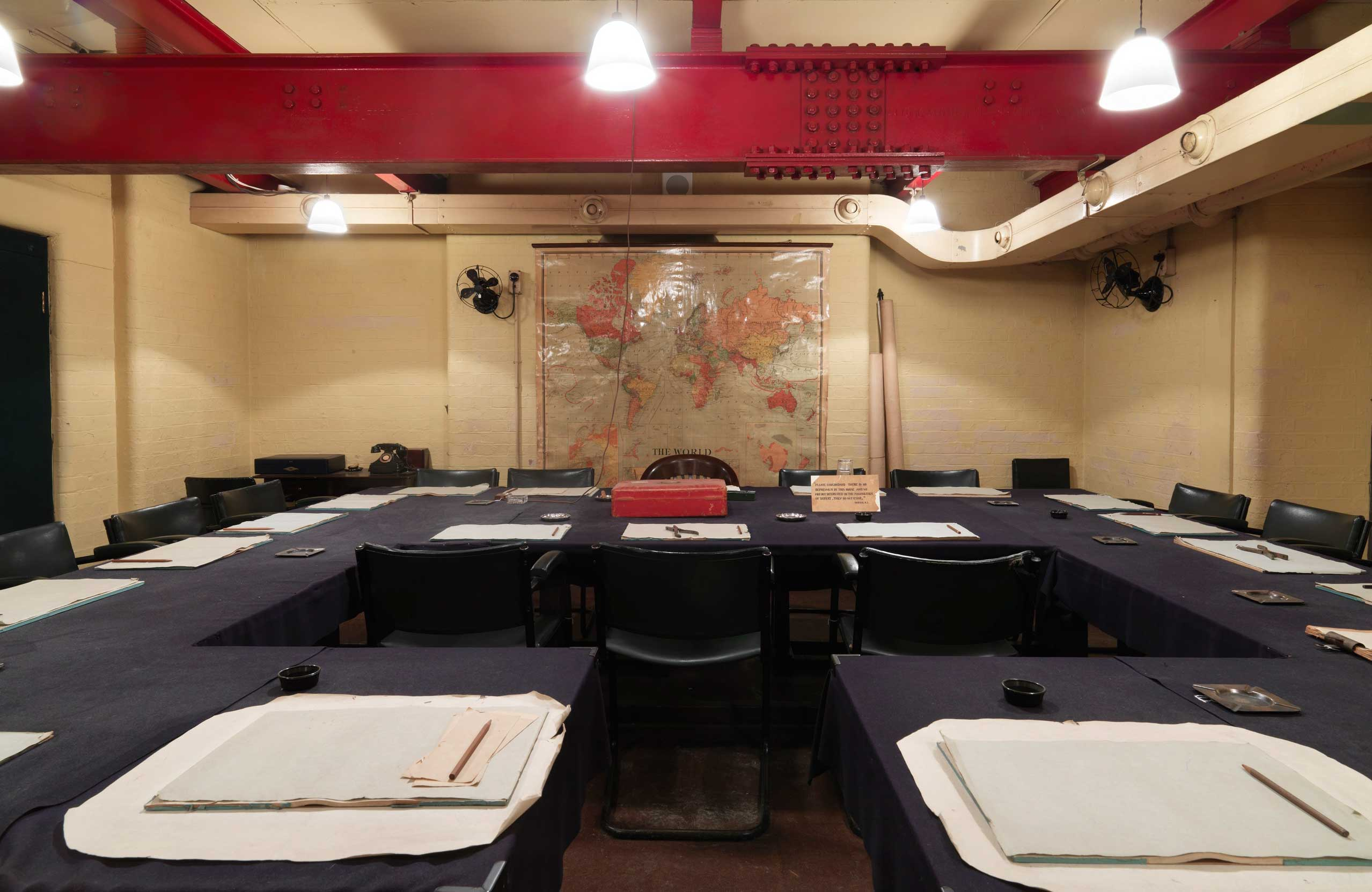 View of the Cabinet Room in Churchill War Rooms with the room set up for a meeting