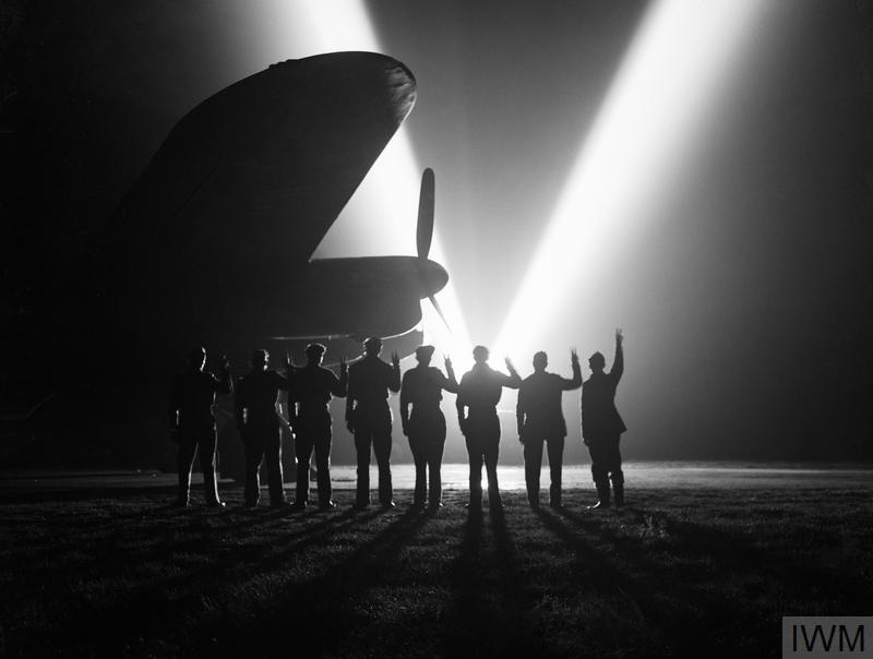 Black and white image of Lancaster and crew