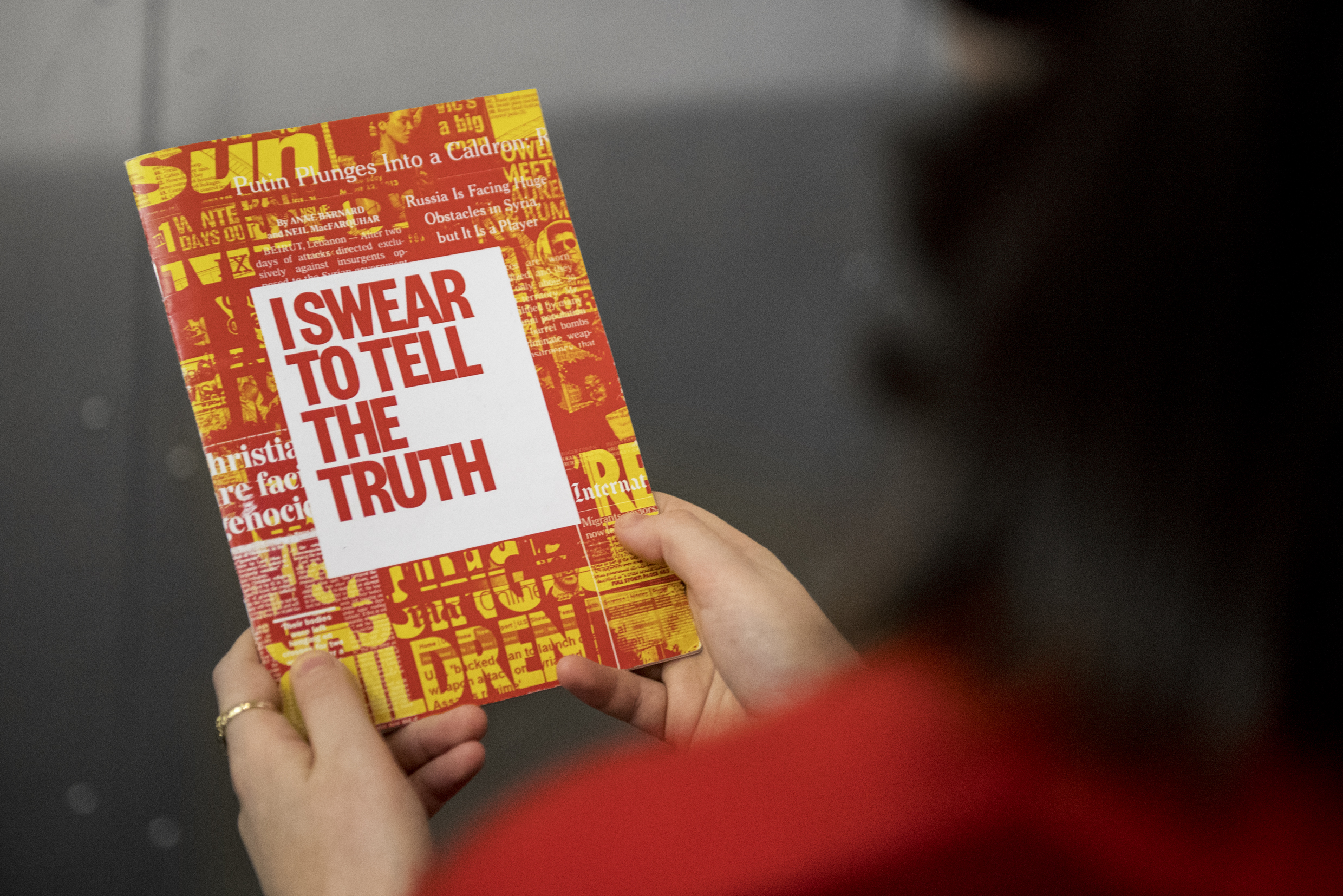 A visitor to IWM North taking part in the I Swear to Tell the Truth experience.