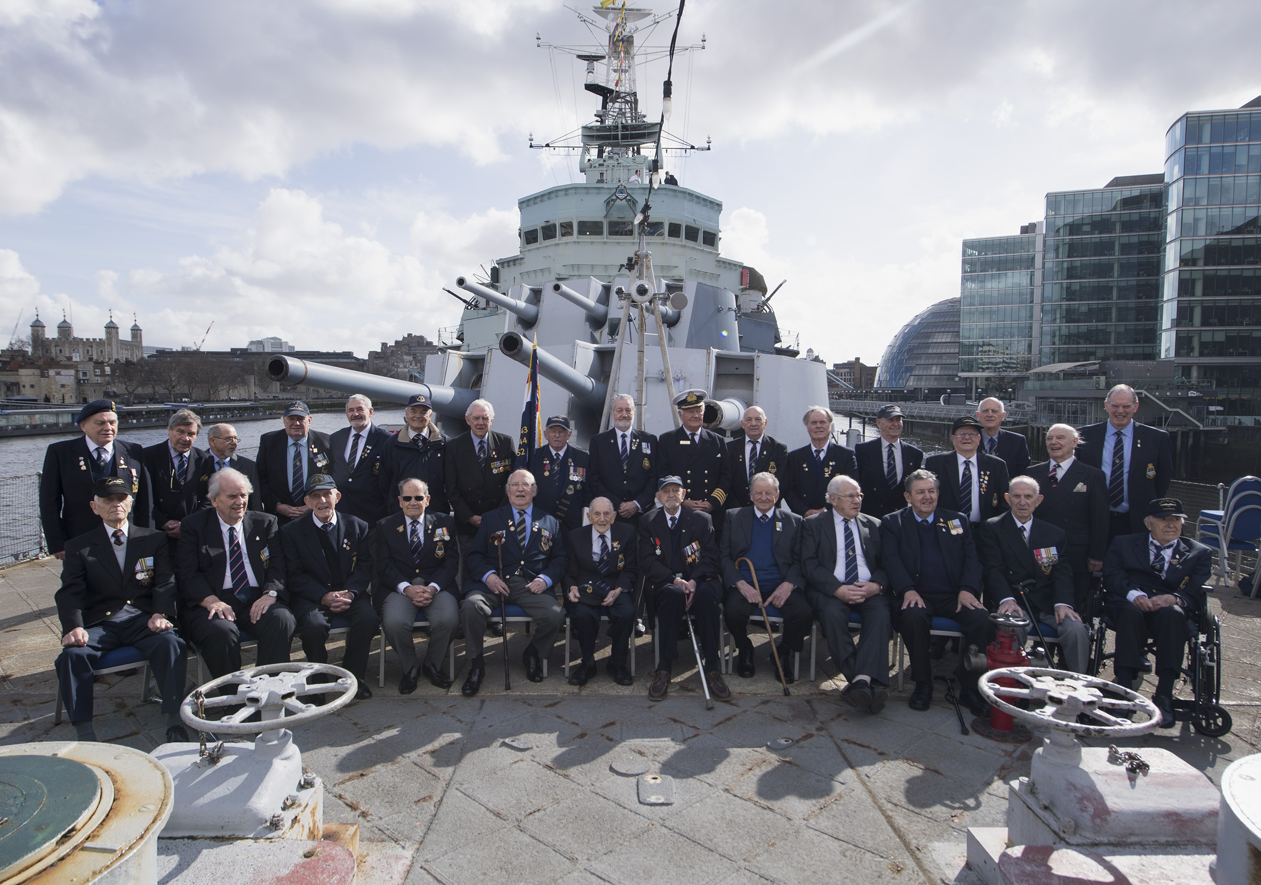 Veterans of HMS Belfast pose for photos on board, March 16 2018