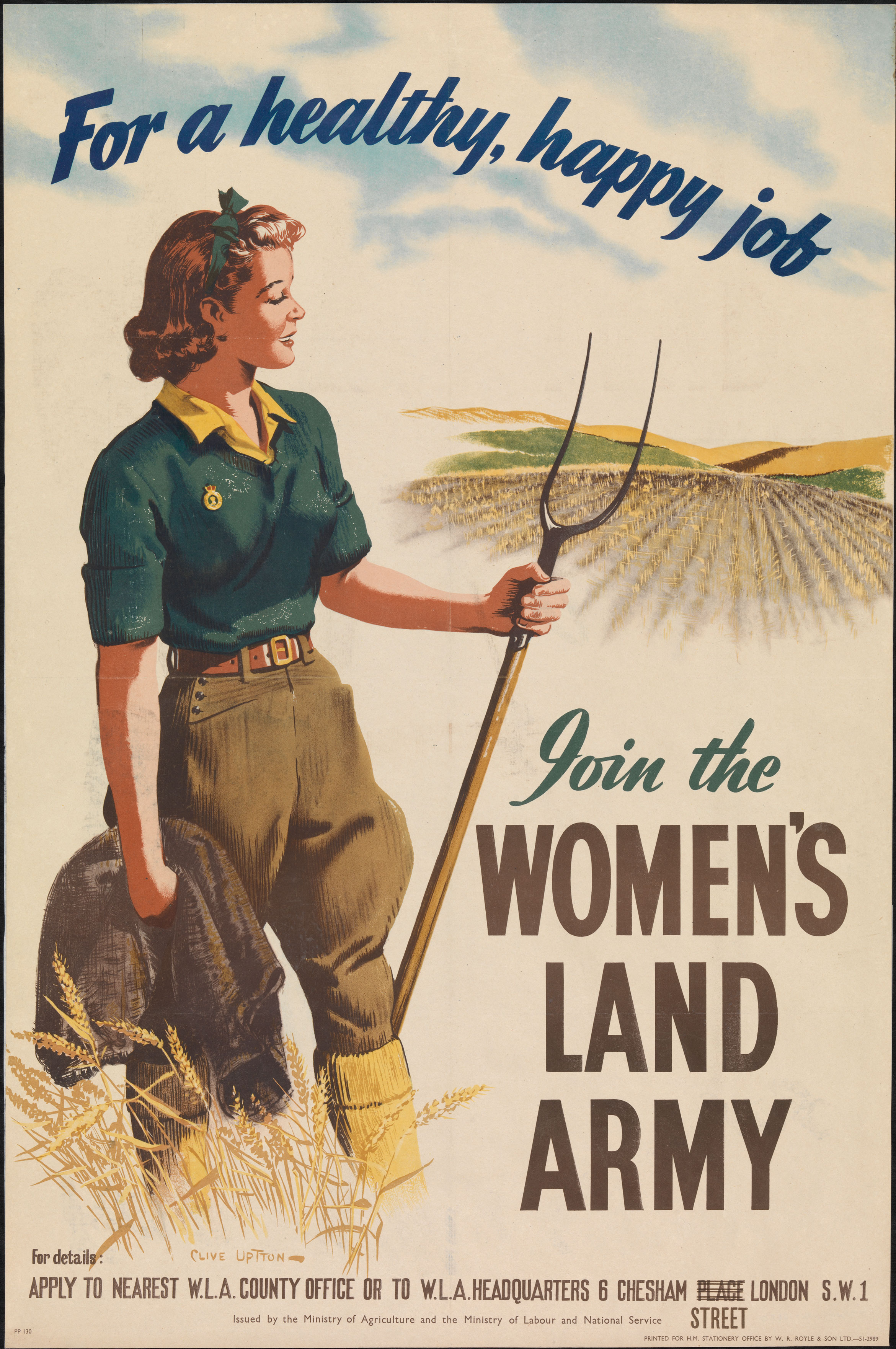 A young woman, wearing the Land Army uniform, stands with a pitchfork in her left hand and holds her jacket in her right. She surveys a field of wheat.
