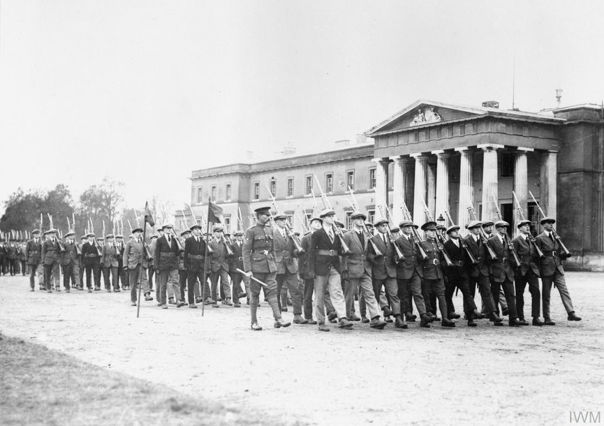 Officer Cadets of the Junion Division (still in civilian cloths) marching past the Old College at the Royal Military Academy Sandhurst, November 1917.