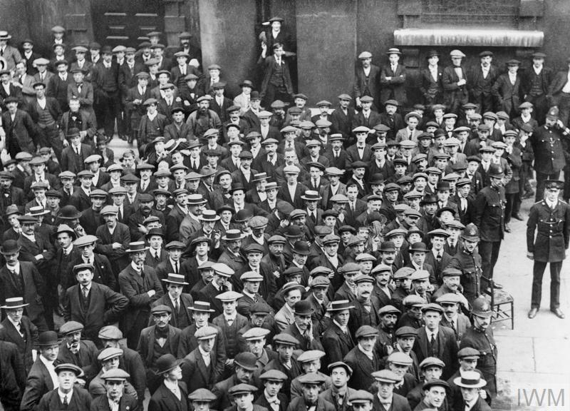 Recruits wait for their pay in the churchyard of St. Martin in the Fields, Trafalgar Square, London, August 1914.