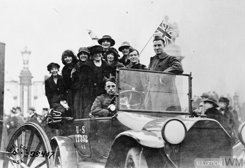 A group of happy girls in an American automobile in London on the day the Armistice was signed, 11 November 1918.