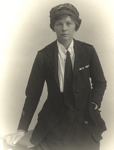 Dorothy Field photographed in her Red Cross uniform after the end of the war. She is wearing the medal ribbons of the 1914-15 Star, the British War Medal and the Victory Medal, and has four chevrons on her arm indicating four years service overseas.