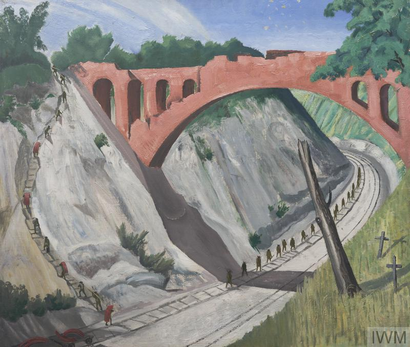 A view of the reddish coloured arched bridge over the Arras-Lens railway. A line of men walk along the railway line, with another line of men walking along a track up the steep cliff face on the left. In the right foreground are two graves marked by crosses and a tree stump.