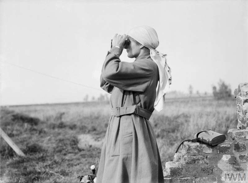 Miss Mairi Chisholm, one of the 'Women of Pervyse' looking through binoculars in Pervyse, 11 September 1917.