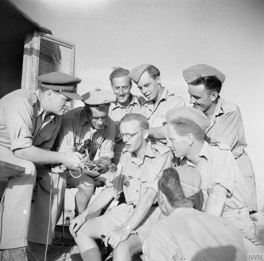 Richard Dimbleby interviewing members of the Army Film and Photographic Unit (AFPU) in North Africa in June 1942.