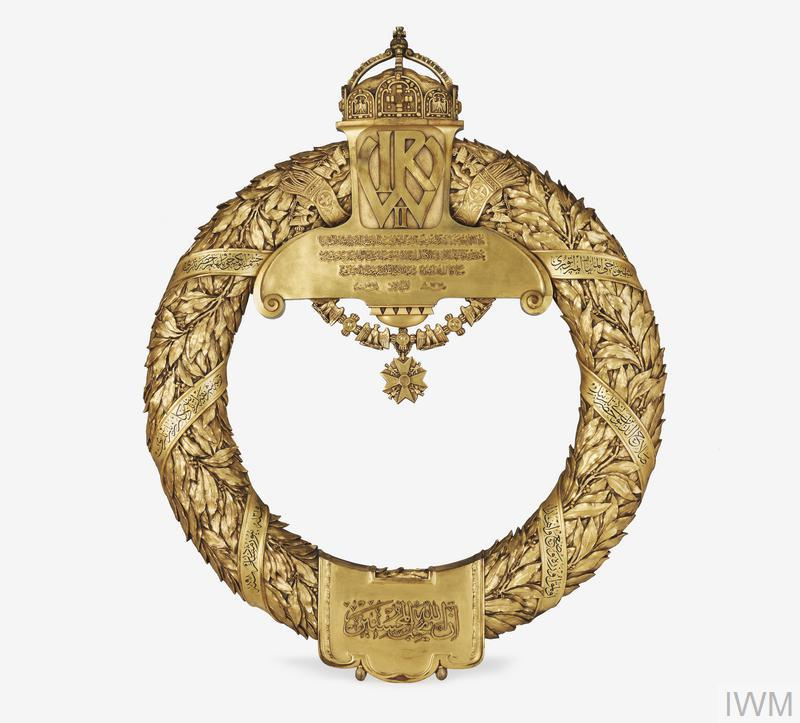 ornate gilt bronze wreath, 74 cm diameter at its widest point. The wreath bears the an embossed Arabic inscription translated as: 'This crown was presented by His Majesty, the Emperor of Germany his presence Wilhelm the Second in memory of his pilgrimage to the tomb of his presence Salah el Din el Ajubi.'