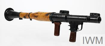 RPG-7V rocket launcher, battle damage to right rear of weapon.