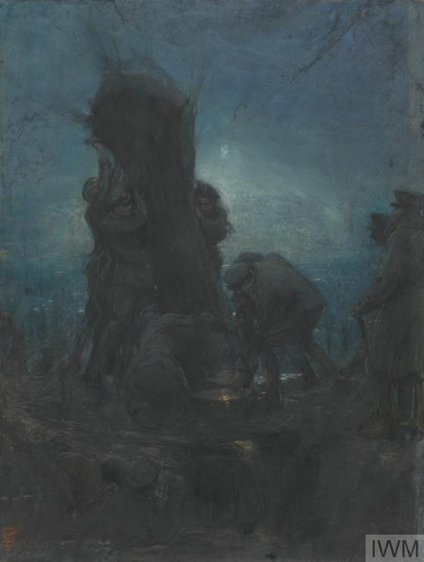 A group of British soldiers erecting a 'camouflage tree' under the cover of night. Two men stand at the base, guiding the trunk in to the hole in the ground, while another three men are visible supporting the upper portion of the trunk. There are two men standing to the side, looking on at the task in hand, and another man crouched in the foreground.
