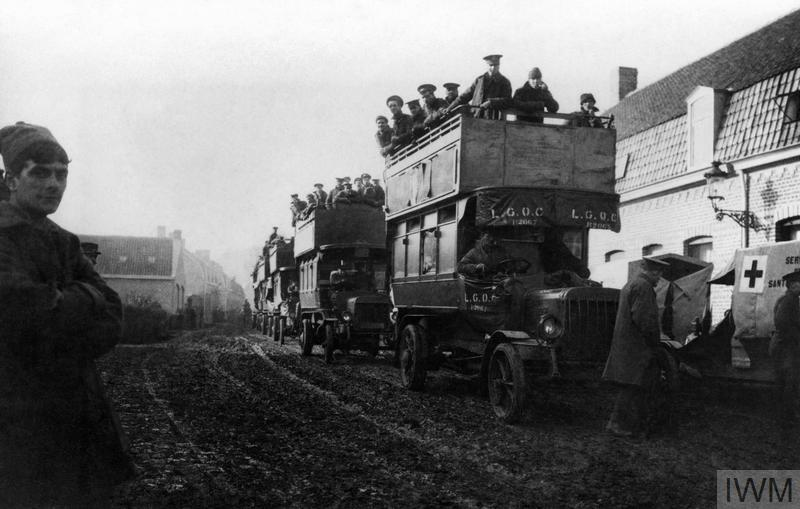 The 2nd Battalion, Royal Warwickshire Regiment being transported by bus through Dickebusch on their way to Ypres, 6 November 1914.