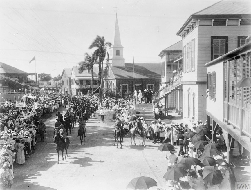 Recruiting and Training in the West Indies: Jamaica: A contingent of West Indian troops marching through Kingston, Jamaica on the way to the harbour, 1916.
