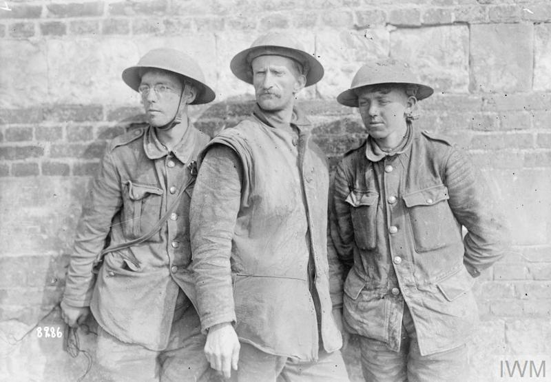 The Battle of the Lys. Three British prisoners captured in Armentieres, 9-18 April 1918.
