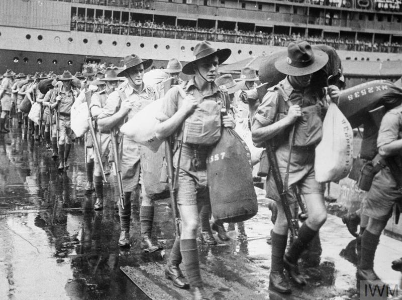 Australian troops march away from a ship after arrival in Malaya