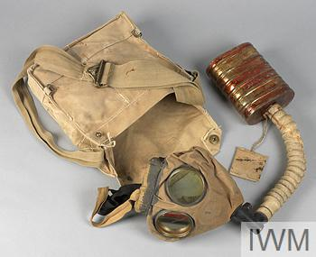 Respirator & haversack The respirator mask consists of a face mask with glass circular eye-pieces set in metal frames, with a flexible ribbed connector hose that is fitted to the metal 'small box' filter. When not in use the whole are neatly packed into the light khaki haversack.