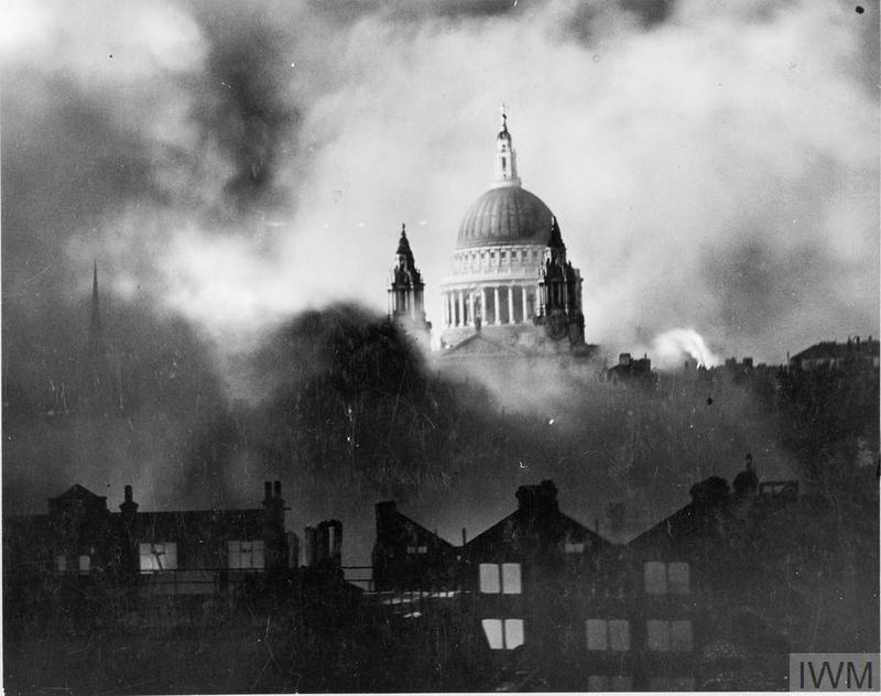 St Paul's Cathedral, rising above the bombed London skyline, is shrouded in smoke during the Blitz. The photograph was taken from the roof of the Daily Mail offices in Fleet Street.