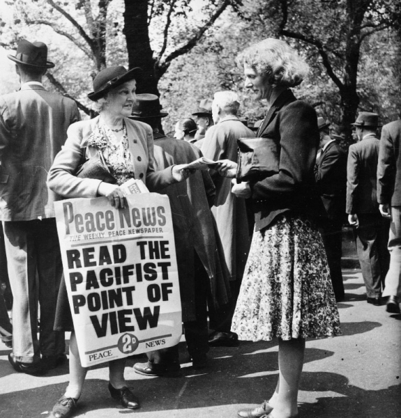 A women sells copies of the pacifist newspaper 'Peace News' in Lincoln's Inn Fields, London, during the Second World War.