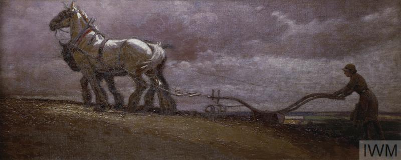 A scene showing two grey horses harnessed to a plough being driven by a Land Girl, moving from right to left of the composition. Beyond the girl is a view of the distant countryside. A storm is brewing in the grey sky above their heads.