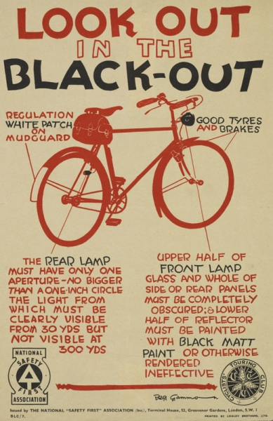 diagram of a bicycle in red against a plain paper background, with labels in red and black indicating necessary features; logos of National Safety First Association and Cyclists' Touring Club at left and right respectively; at the bottom of the text, but above the publisher's notice, is a thick red line with wavy ends. text: LOOK OUT IN THE BLACK-OUT.