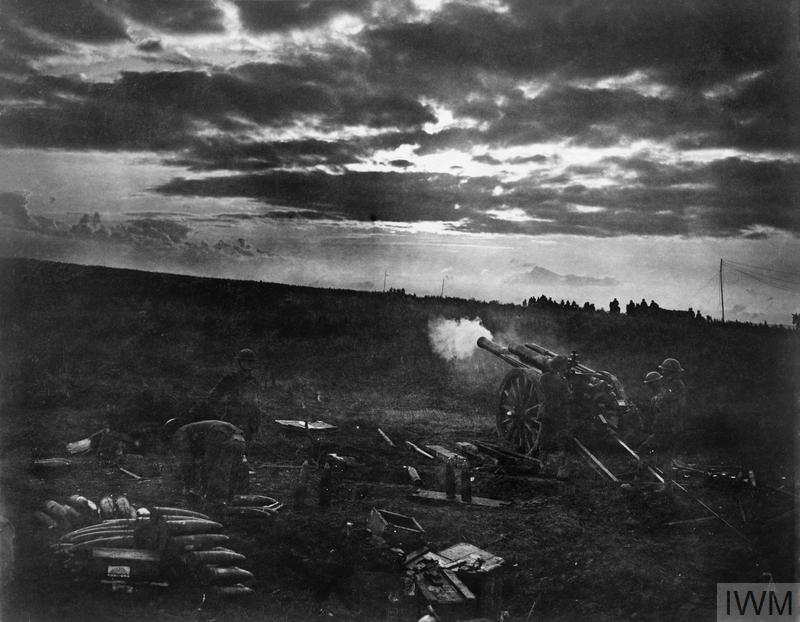 Battle of Canal du Nord. A 60pdr. firing in the dawn barrage, dimly seen field batteries go forward on the right, part of the British advance near Moeuvres, 27th September 1918. (See also Q 9324).