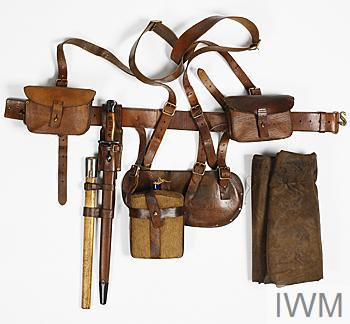 Personal equipment comprising waistbelt, support braces (2), ammunition pouches (2), bayonet frog, entrenching tool cover and waterbottle; all fittings made of brown leather.