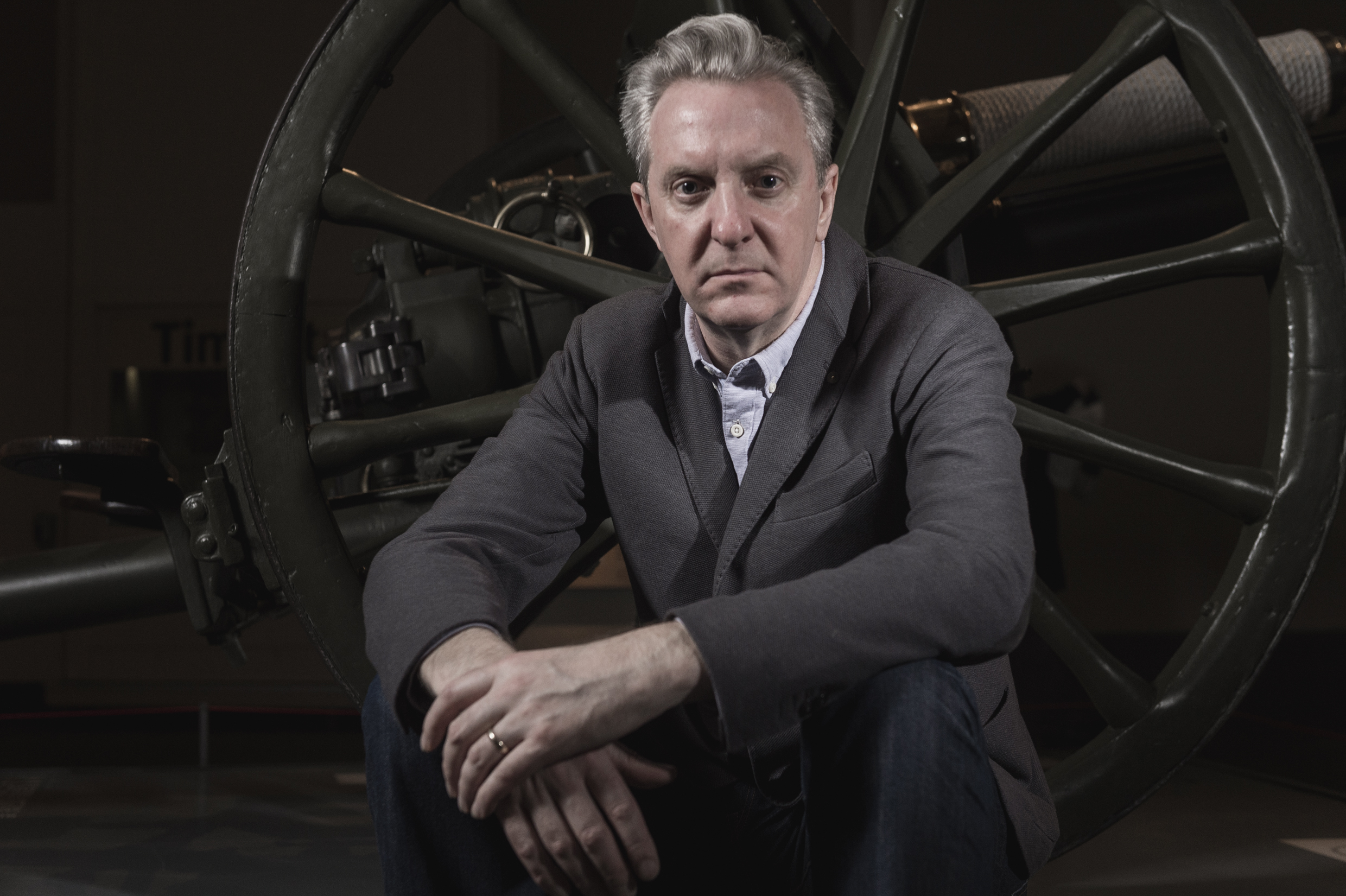 Leading poet Tony Walsh sitting in the Main Exhibition Space at IWM North.