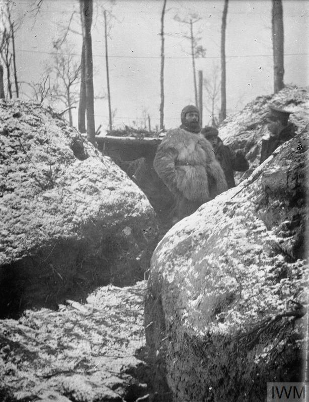 Soldiers of the machine gun section of the 11th Regiment Hussars (Prince Albert's Own) in the trenches at Zillebeke, January - February 1915. The man wearing the balaclava is Corporal Peel, who went on to become the unit's Regimental Sergeant Major in 1930.