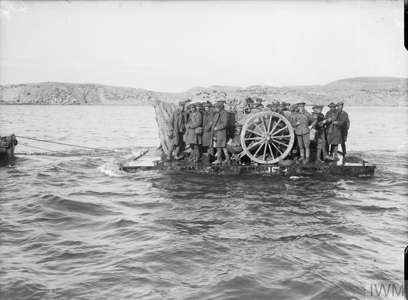 British troops and their artillery guns being evacuated from Suvla Bay on rafts in daylight, December 1915.