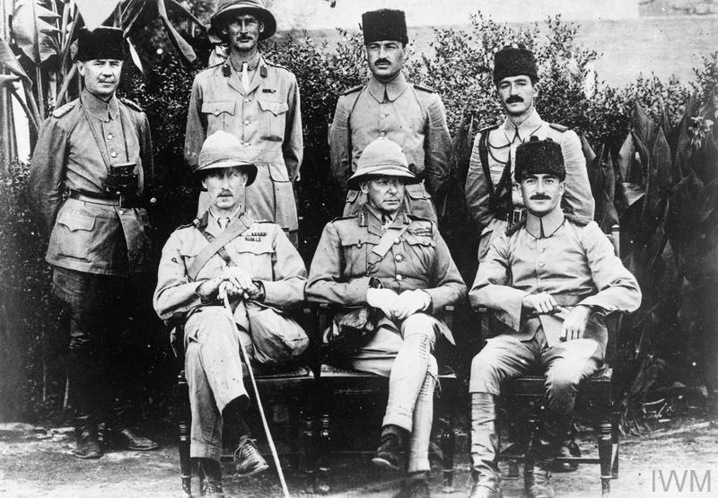 General Charles Vere Ferrers Townshend KCB DSO (1861-1924) with Khalil Pasha and staff shortly after the surrender of Kut. Front row: Colonel Parr, General Townshend, and Khalil Pasha. Back row: Naum Bay, Captain W E T Morland, Naum Hava, and Faud Bey.