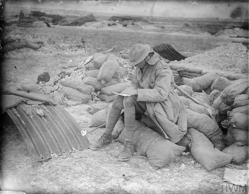 An Australian soldier writes a letter home from his billet on the Somme front, 1916.