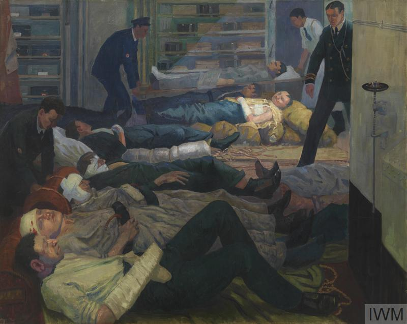 The interior of a cabin below deck with several wounded sailors, most swathed in bandages, laid out parallel to one another across the floor. They are tended to by three orderlies and one naval doctor who is standing on the right and has a stethoscope round his neck. Two of the orderlies are lowering a wounded man on a stretcher to the floor in the background.