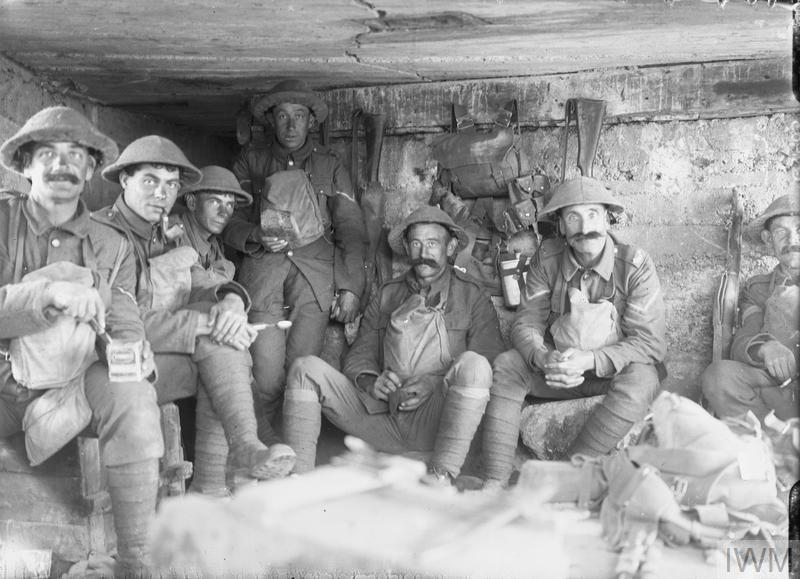 Men of the West Yorkshire Regiment sitting in a captured German pill box waiting to go into action, near the St Julien - Grafenstafel road during the Battle of Polygon Wood, 26 September - 3 October, part of the Battle of Passchendaele.