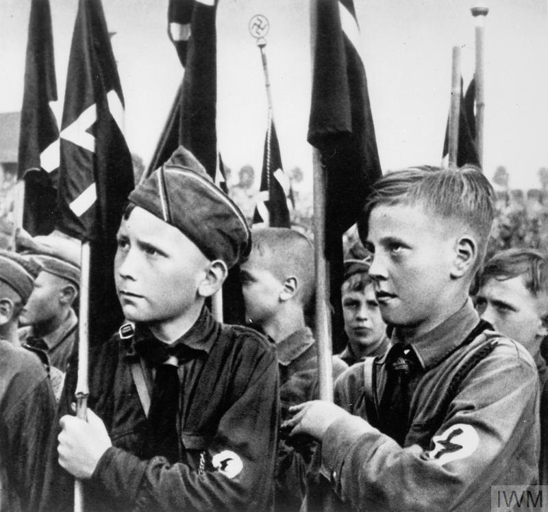 Life in Nazi Germany young boys holding flags.
