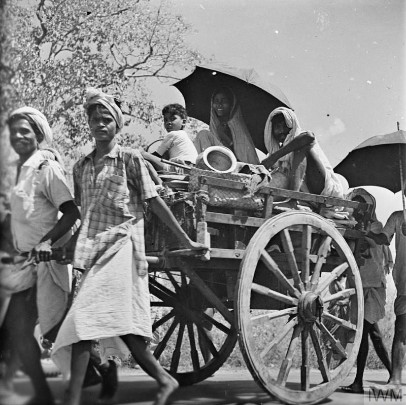 Burmese civilians pulling a cart during the evacuation of Rangoon, 1942.