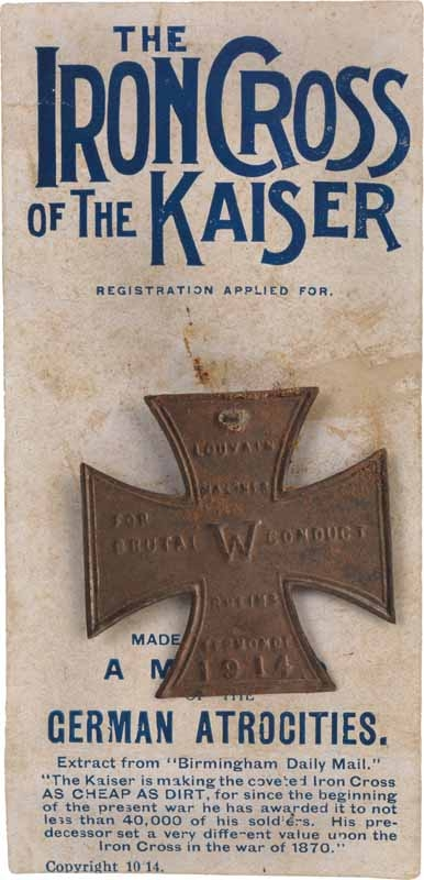 'The Iron Cross of the Kaiser' comprising an iron cross replica pinned to a printed card inscribed 'THE IRON CROSS OF THE KAISER. MADE IN ENGLAND. A MEMENTO OF THE GERMAN ATROCITIES.'