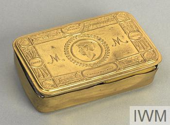 box, pkt of tobacco, pkt of cigarettes standard decorative brass Princess Mary's Gift Fund box containing a packet of tobacco and carton of cigarettes.