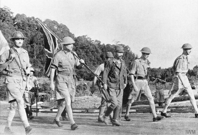 Lieutenant-General Arthur Percival and his party carry the Union Jack on their way to surrender Singapore to the Japanese, 15 February 1942.