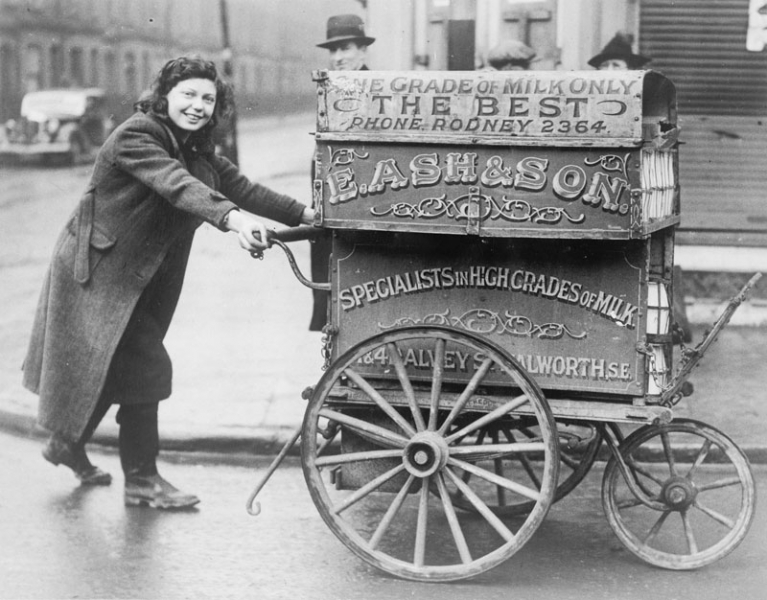Fifteen year old Rose Brown of Marcia Road, Walworth, has taken the place of a milkman who was called up for the Forces. Every morning at 8 o'clock Rose starts out on her rounds pushing a heavily laden milk barrow. At 2 pm she finishes and returns to the dairy to give a hand in the bottling department until 5 pm.