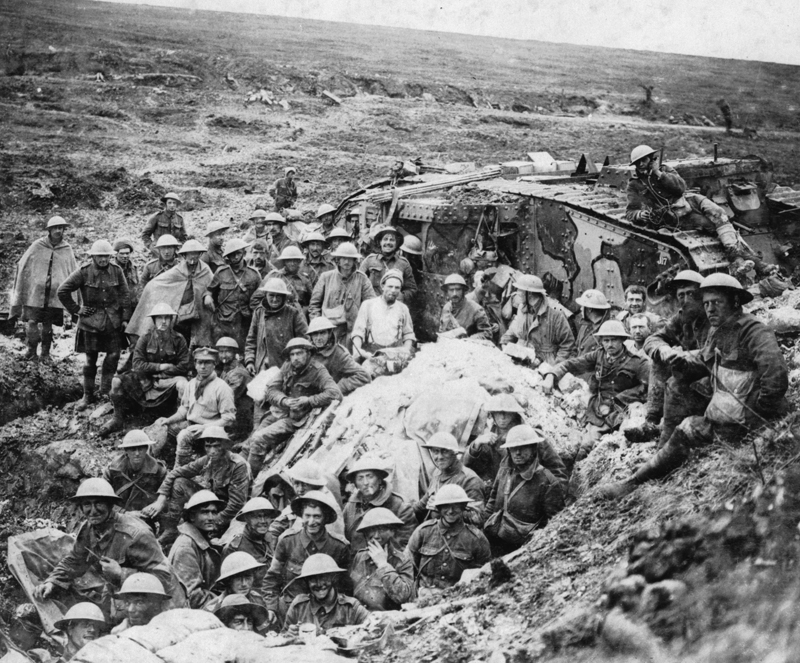 The Battle of Flers Courcelette. The Mark I tank (D 17) surrounded by some of the infantry from 122nd Brigade whom it led into eastern part of Flers on 15 September 1916. Photograph taken on 17 September 1916.