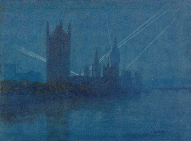 a view across the Thames showing searchlights in the night sky above the Palace of Westminster.