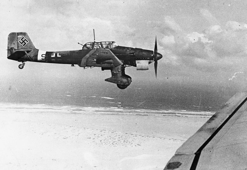 "Junkers Ju 87B dive-bomber , in flight over the Channel Front, 1940. The infamous ""Stuka"", a name derived from an abbreviation of the term ""Sturzkampffleugzeug"" meaning dive-bomber, acheived notoriety during the Blitzkrieg truimps of 1939-1940. During the Battle of Britain, though, the ""Stukas"" were slaughtered by RAF fighters."